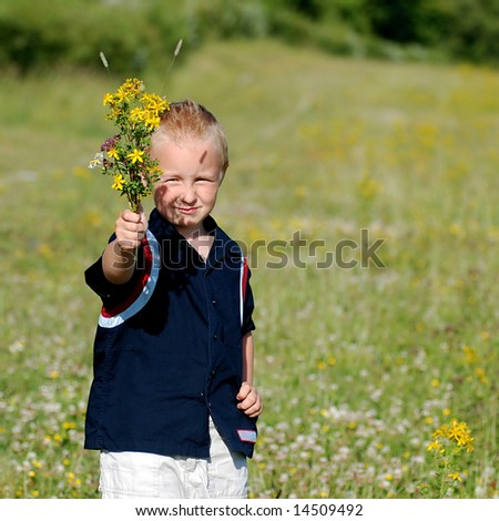 Boy giving bouquet of flowers