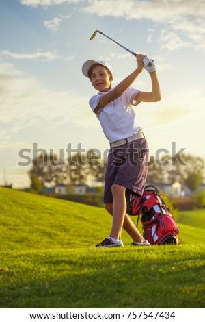 boy golf player hitting by iron ...