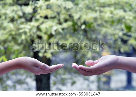 Boy hand and nature background , Ecology concept . Ecology concept . #553031647