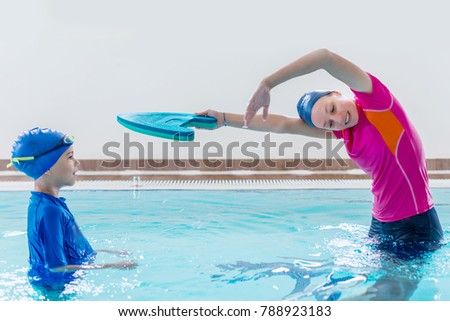 Boy having a swimming lesson with instructor Stockfoto ©
