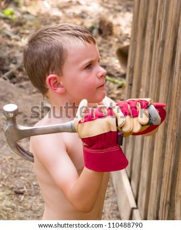 Boy helping Dad - stock photo