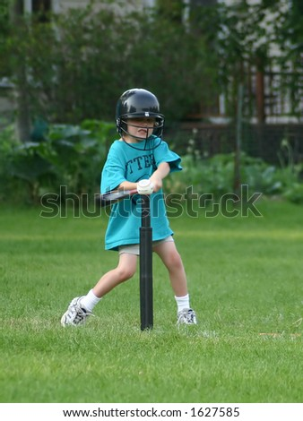 Boy hitting ball off of the Tee