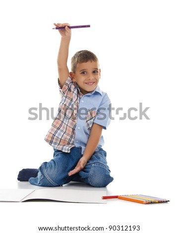boy holding a pencil in his hand and shows  how to grow