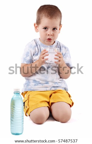 Boy holding bottle of water isolated on white background