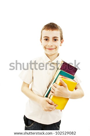 Boy holding colored books. All on white background.
