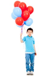 Boy holding colorful balloons - isolated over a white background