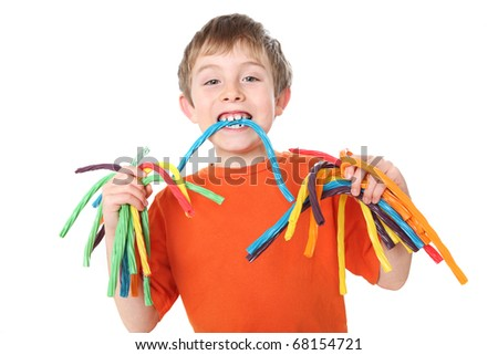 Boy holding colorful licorice candy