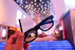 Boy holding 3D glasses and tickets, ready to fun
