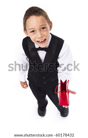 boy holding red bad with a gift in his hands