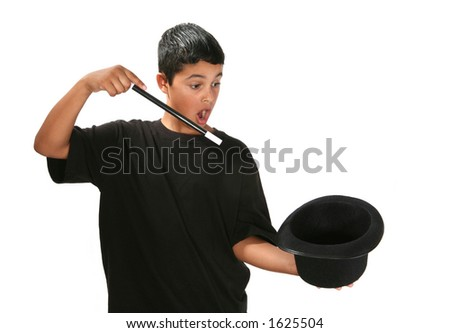 Boy holding wand and magic hat