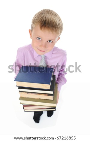 boy holds a stack of books. Isolated on white background