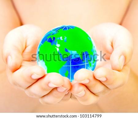 boy holds globe in hands
