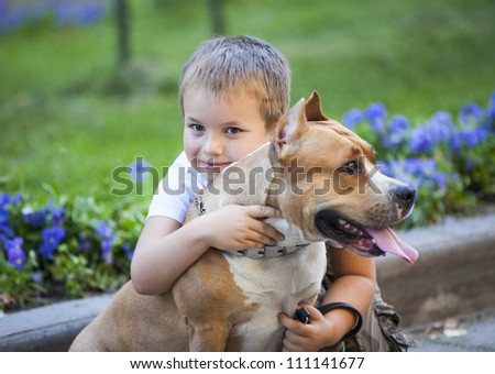 boy hug the dog. family and pet concept - stock photo