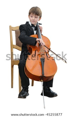 Boy in a black suit, playing the cello.