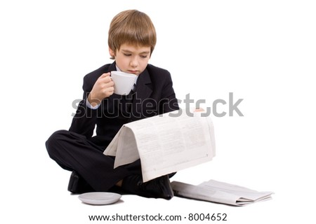 Boy in a business suit with a cup, isolated over white