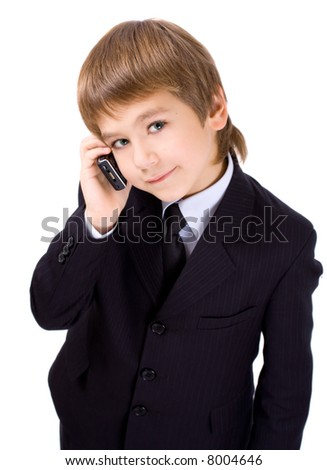 Boy in a business suit with a mobile telephone, isolated over white