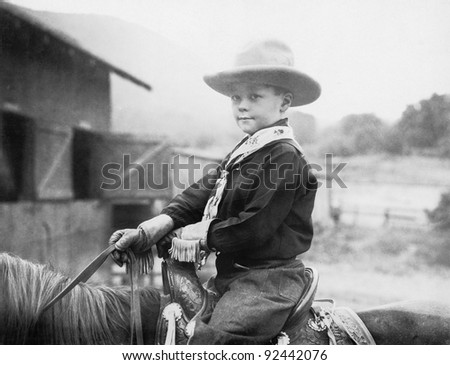 boy in a cowboy hat on a horse