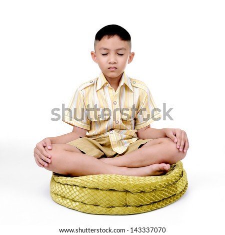 Boy in a lotus pose meditation and yoga