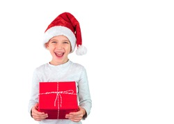 Boy in a Santa hat holds a gift isolated on white and smile.