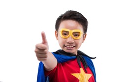 Boy in a superhero costume showing thumbs-up