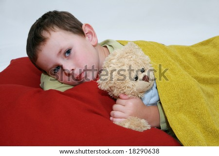 Boy in bed five years old boy lying in bed with teddy for 5 yr old beds