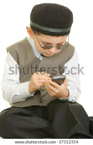 Boy in black cap and sunglasses with palm computer