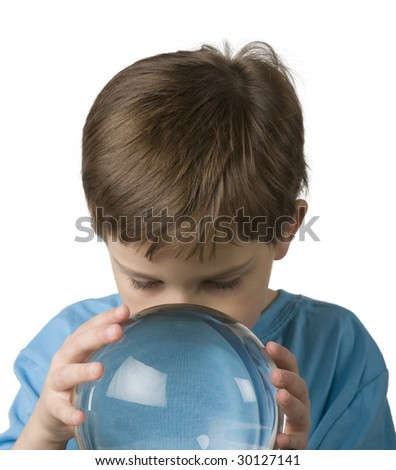 Boy in blue shirt plays with crystal ball