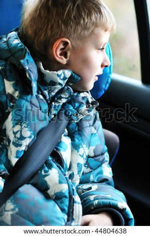stock-photo-boy-in-carseat-looking-in-the-window-44804638.jpg