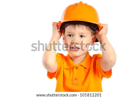 boy in construction helmet isolated on white background - stock photo