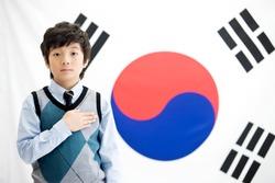 boy in front of Korean flag, Taegeukgi