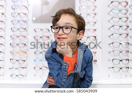 boy in glasses , at optics store  #585043909