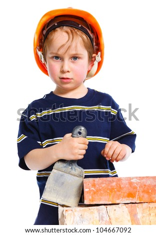 Boy in hard hat with brick. Isolated white backround