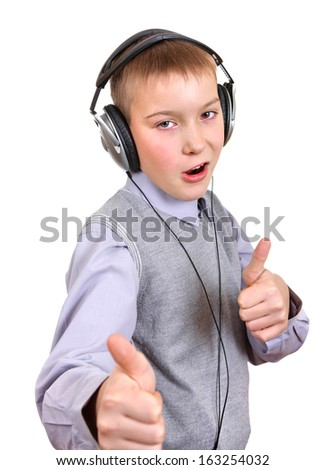 Boy in Headphones shows OK Gesture Isolated on the White Background