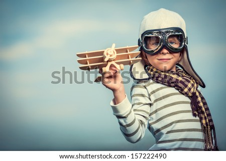 boy in helmet and glasses with...