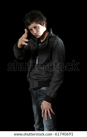 boy in jacket pointing at camera