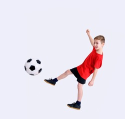 boy in red shirt with soccer ball in front of white background