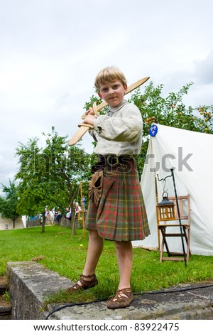 boy in scottish dress