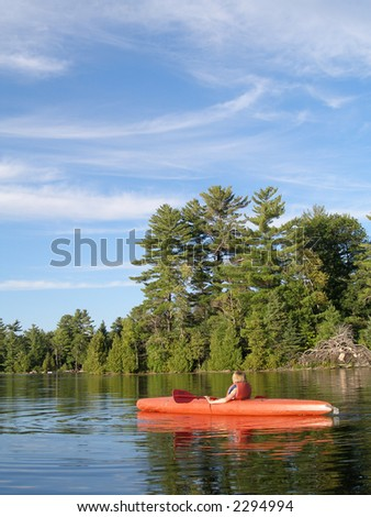 boy in the canoe on the lake