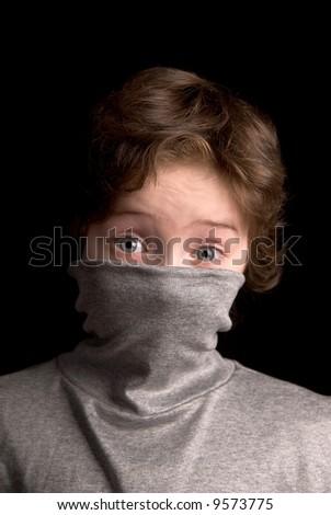 Boy in Turtleneck over a black background