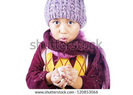 Boy in winter outfit isolated over white