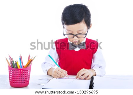 Boy is drawing with his pencil color isolated on white