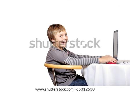 Boy is enjoying online gaming, isolated on white