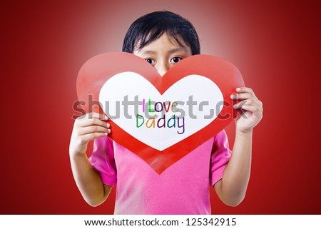 Boy is holding a love card for his daddy