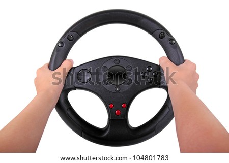 boy is holding a toy steering wheel