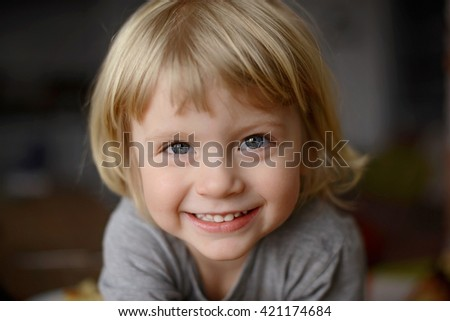 boy is looking to the camera and smiling #421174684