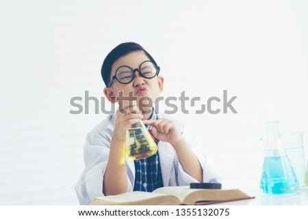 boy is making science experiments in a laboratory #1355132075
