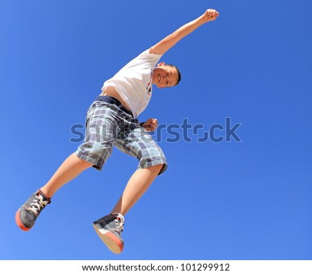 boy jumping against the blue sky
