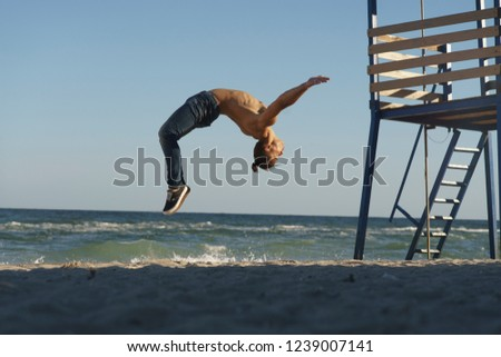 f8e4cefe4948fb Free photos A man doing flips at the beach