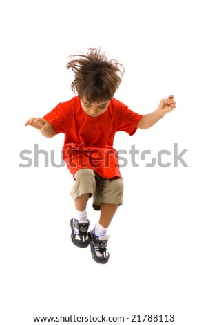 Boy jumping on white background .