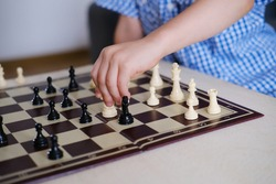 boy, kid plays with his father, an adult in chess, the concept of the development of mental abilities, logic, the ability to play, family entertainment, joint games, business, victory